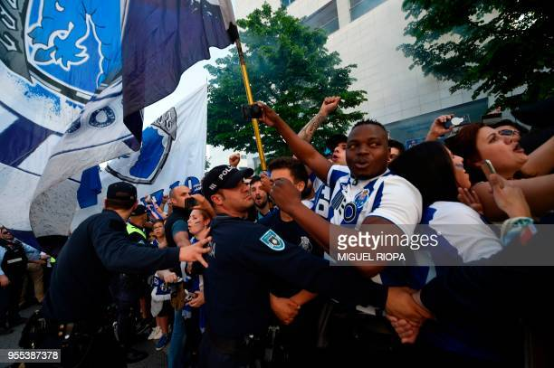Police stand guard as Porto's supporters wait to greet the team bus outside the Dragao stadium in Porto ahead of the Portuguese league football match...