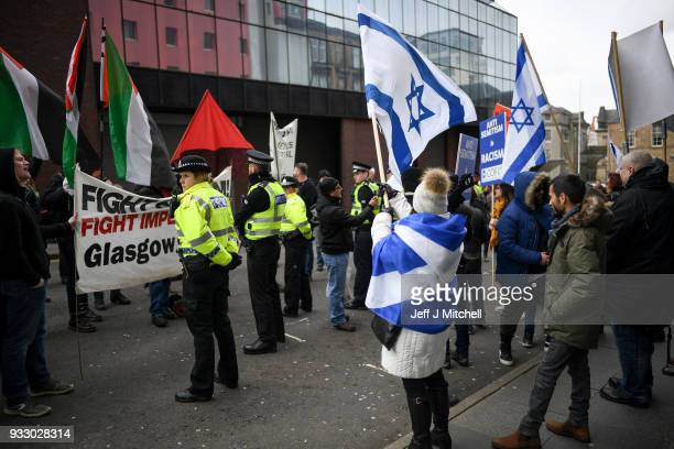 Police stand guard as ProIsraeli and Pro Palestine demonstrators try and stop each other from marching during an antiracism rally through the city...