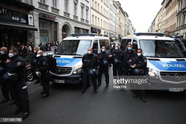 Police stand guard as protesters take part in a demonstration in Kreuzberg on May Day during the novel coronavirus crisis on May 1 2020 in Berlin...