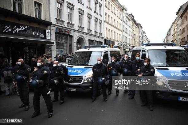 Police stand guard as protesters take part in a demonstration in Kreuzberg district on May Day during the novel coronavirus crisis on May 1 2020 in...