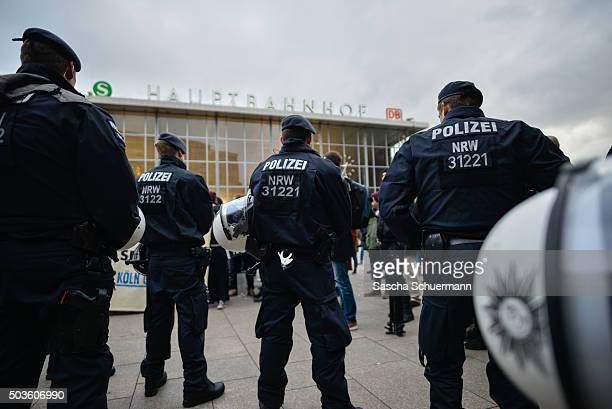 Police stand guard as supporters of Pro NRW a rightwing populist group that has campaigned against the construction of new mosques in the German...