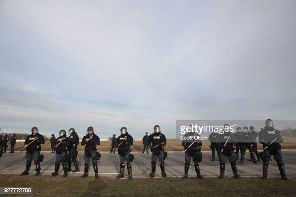 Police stand guard as white nationalists clash with counterdemonstrators before the start of a speech by white nationalist Richard Spencer who...