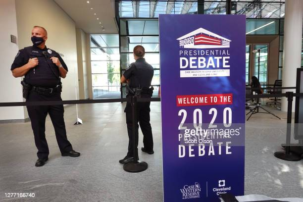 Police stand guard as workers prepare the venue for the first presidential debate between U.S. President Donald Trump and Democratic presidential...