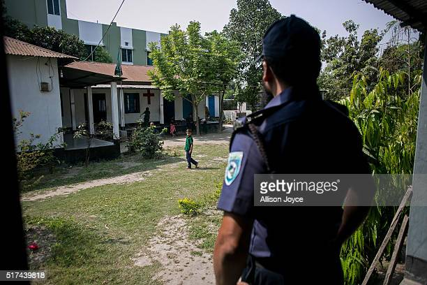 Police stand guard at a Protestant church who's Pastor received death threats from ISIS on March 24 2016 in Rangpur Bangladesh Pastor Manik's name...