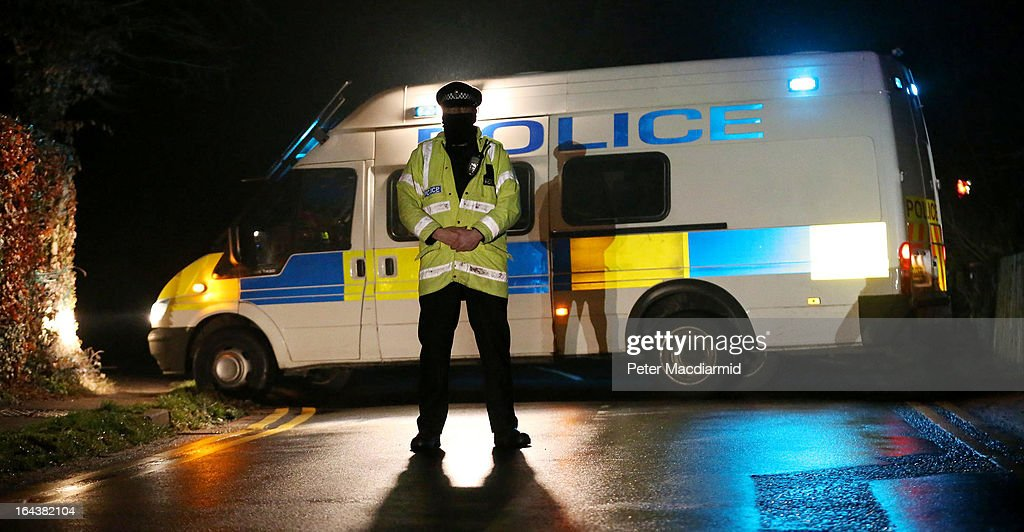 Police stand guard at a road block near to where it is believed Boris Berezovsky lived on March 23, 2013 near Sunningdale, England. Local media are reporting that Russian oligarch Boris Berezovsky has been found dead in his bath at home.