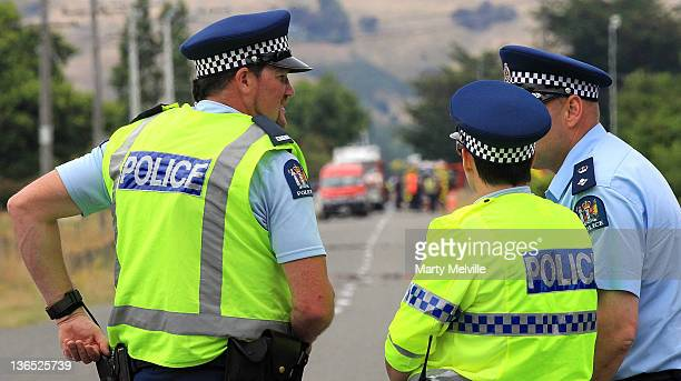 Police stand guard at the cordon near the accident site on January 7 2012 in Carterton New Zealand Emergency services attended a hot air balloon...