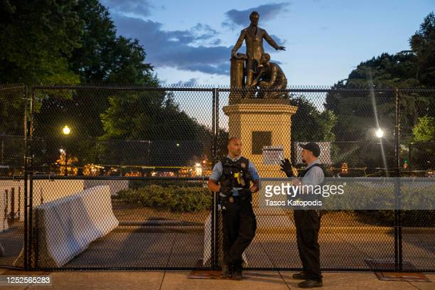 Police stand guard at the Emancipation Memorial debate in Lincoln Park on June 25 2020 in Washington DC The Army has activated 400 unarmed Washington...
