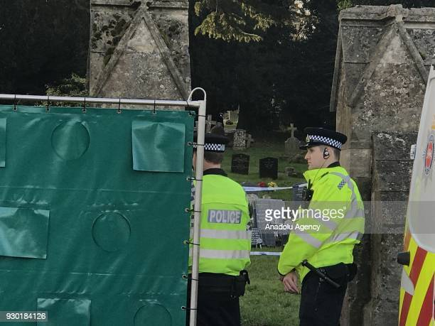 Police stand guard at the grave site of former Russian spy Sergei Skripal's wife as the grave is opened for autopsy within the investigation carried...