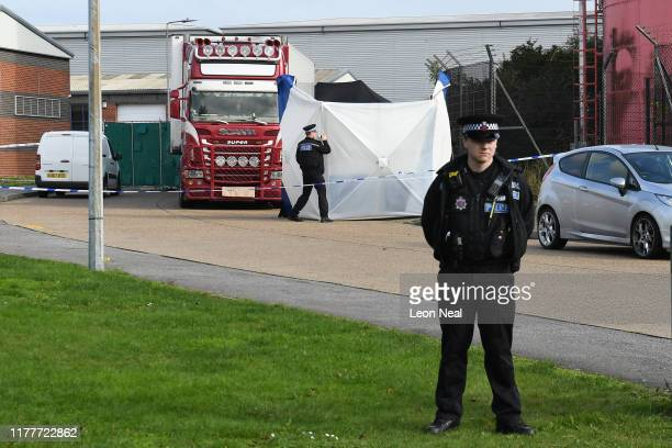 Police stand guard at the site where 39 bodies were discovered in the back of a lorry on October 23, 2019 in Thurrock, England. The lorry was...