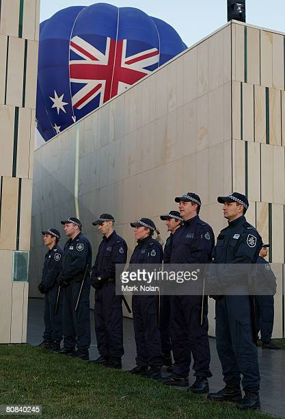 Police stand guard before the start of the Olympic Torch relay at Reconciliation Place on April 24 2008 in Canberra Australia The relay route in the...