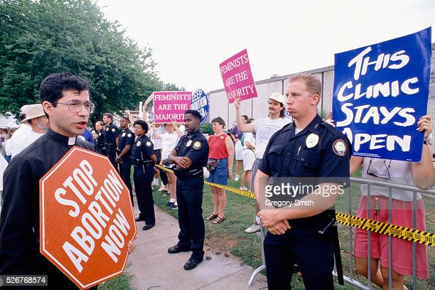 Police stand guard between a group of antiabortion protesters and a group of prochoice protesters outside a clinic in Little Rock Arkansas At the...