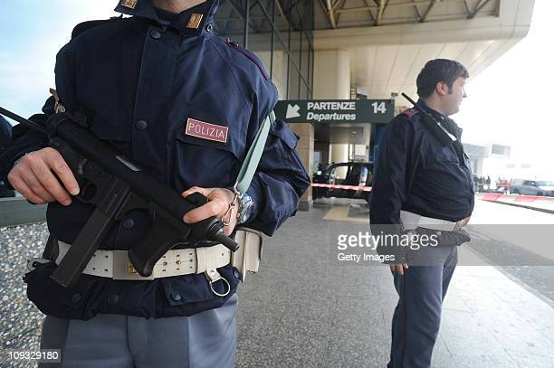 Police stand guard by a car that crashed into in the departure terminal of Malpensa Airport on February 21 2011 in Milan Italy A Tunisian man Ben...