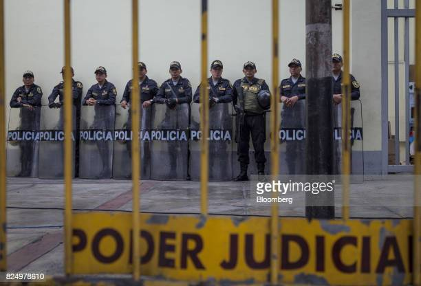 Police stand guard during a hearing for former Peruvian President Ollanta Humala and his wife Nadine Heredia outside the National Criminal Court in...