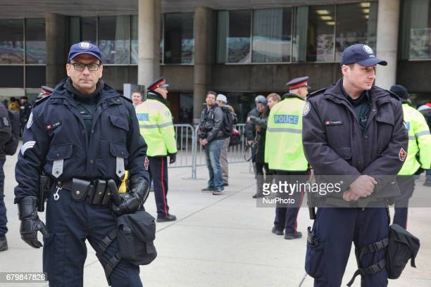 Police stand guard during a rally against Islam Muslims and Sharia Law in downtown Toronto Ontario Canada on May 06 2017 Groups such as the Concerned...