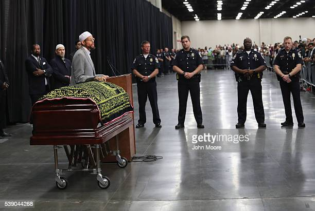Police stand guard during an Islamic prayer service for Muhammad Ali at the Kentucky Exposition Center on June 9 2016 in Louisville Kentucky The...