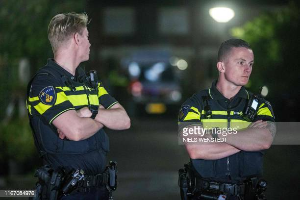 Police stand guard during the investigation of a house after a shooting incident in which several victims were killed, on the Heimerstein in...