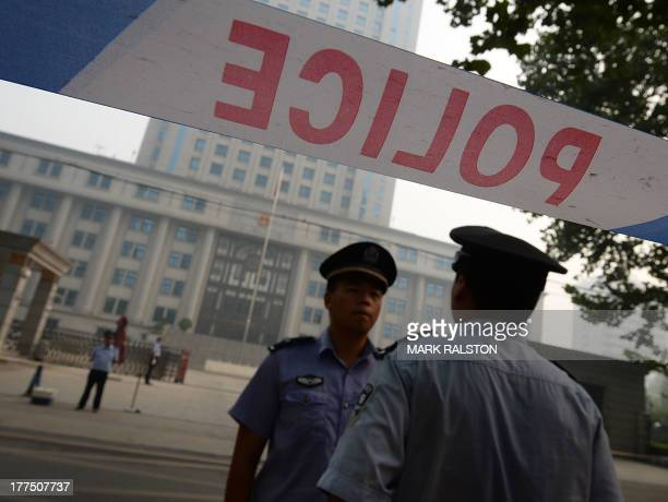 Police stand guard during the third day of the trial of disgraced politician Bo Xilai at the Intermediate People's Court in Jinan Shandong Province...