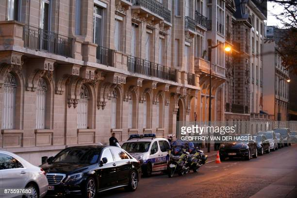 Police stand guard in front of a building in Paris on November 18 2017 after Lebanese Prime Minister Saad Hariri arrived from Saudi Arabia to meet...