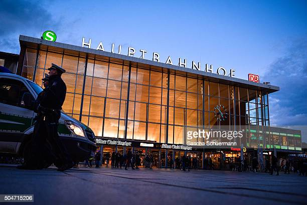 Police stand guard in front of Hauptbahnhof main railway station stands near Hauptbahnhof main railway station where on New Year's Eve gangs of what...