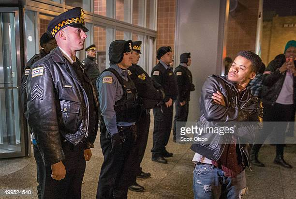 Police stand guard in front of the City of Chicago Public Safety Headquarters during a protest over the killing of Laquan McDonald on December 1 2015...