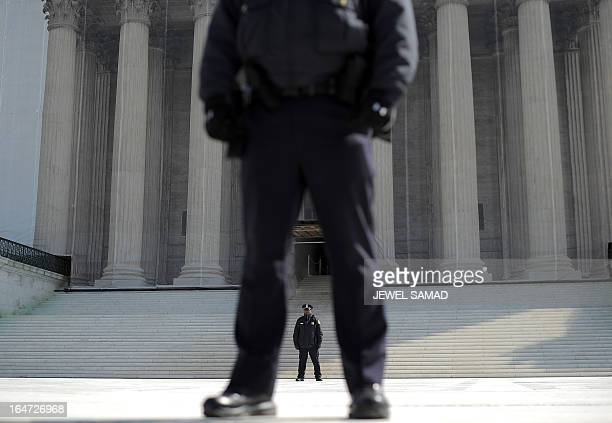 Police stand guard in front of the Supreme Court on March 27 2013 in Washington DC The US Supreme Court tackled samesex unions for a second day...