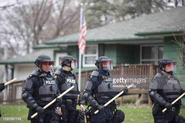 Police stand guard inside the perimeter of the scene where Brooklyn Park police killed Duante Wright, who was shot by an officer during a traffic...
