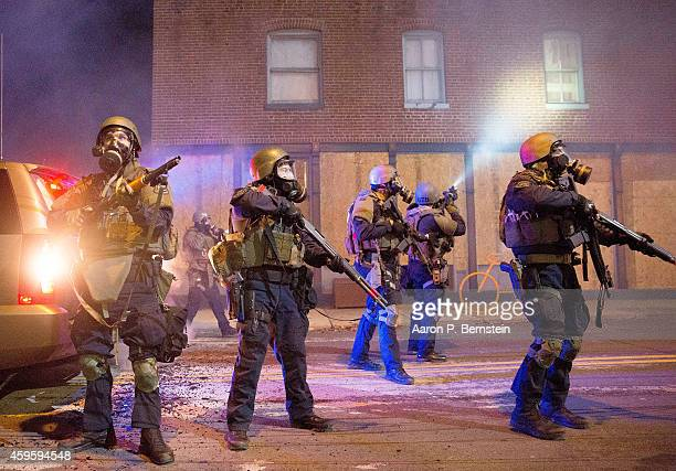 Police stand guard near City Hall during protests on November 25 2014 in Ferguson Missouri Over 2000 Missouri national guardsmen are being deployed a...