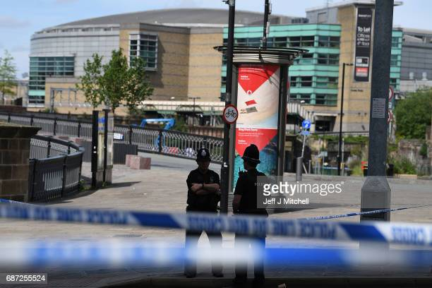 Police stand guard near the Manchester Arena on May 23 2017 in Manchester England At least 22 people were killed in a suicide bombing at an Ariana...