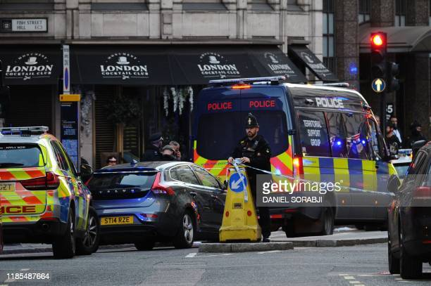 Police stand guard near The Monument in London, on November 29, 2019 after reports of shots being fired on London Bridge. - The Metropolitan Police...