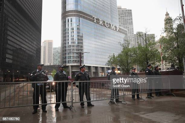 Police stand guard near Trump Tower as they wait for demonstrators fighting for a $15perhour minimum wage to march past on May 23 2017 in Chicago...