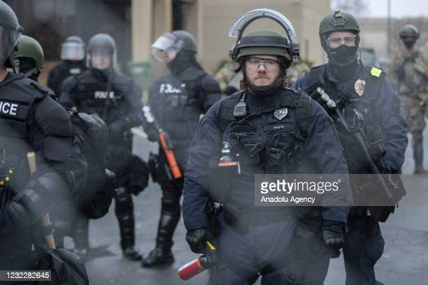 Police stand guard of the Brooklyn Center police department after the police killing of Daunte Wright in Brooklyn Center, Minnesota, U.S., on April...