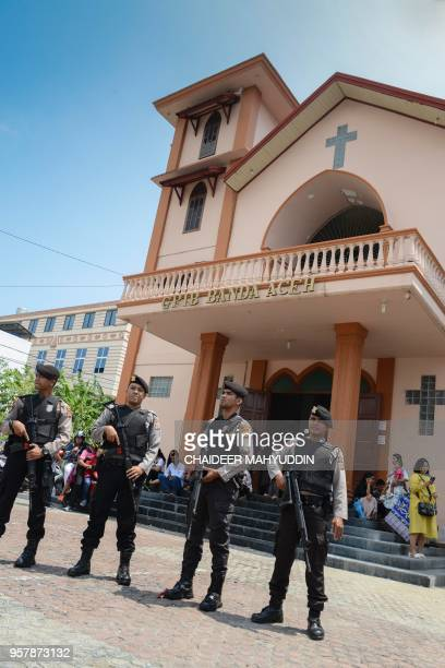 Police stand guard outside a church in Banda Aceh on May 13 2018 following attacks on churches in Surabaya East Java A wave of blasts including a...