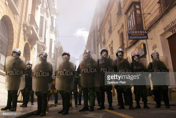 Police stand guard outside of congress during outbreaks of violence between the police and demonstrators May 31 2005 in La Paz Bolivia Thousands of...