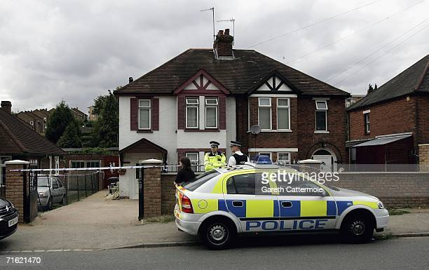Police stand guard outside of number 41 Micklefield Road after it was sealed off following a police raid on August 10, 2006 in High Wycombe, England....