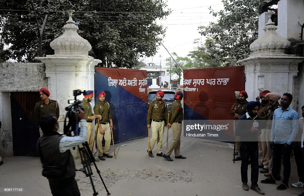 Police stand guard outside the entrance gate of the highsecurity Nabha jail in Patiala from where one militant and 4 other inmates escaped at Nabha...