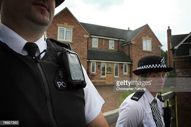 Police stand guard outside the home of Gerry and Kate McCann after their arrival on September 9 2007 in Rothley England The McCann family have...