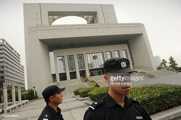 Police stand guard outside the Intermediate People's Court in Hefei Anhui province before the sentencing of Gu Kailai wife of the disgraced leader Bo...