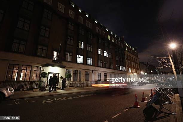 Police stand guard outside the King Edward VII Hospital where Queen Elizabeth II has been admitted after suffering from symptoms of gastroenteritis...