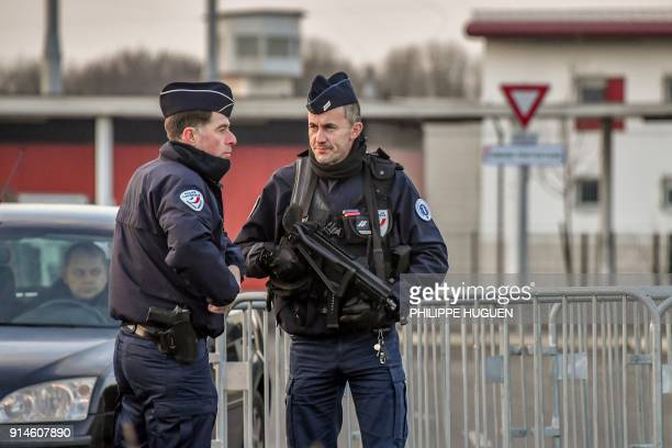 Police stand guard outside the prison of VendinleVieil northern France where will be kept the only surviving suspect in the November 2015 Paris...