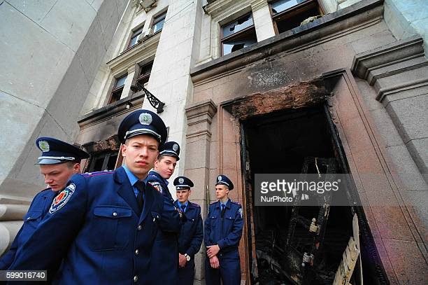 Police stand guard outside the Trade Union building Odessa. More then 30 people were killed after they were trapped inside the building. Many...