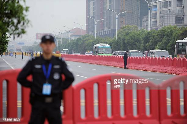 Police stand guard outside the Xianning Intermediate People's Court where Chinese mining tycoon Liu Han stands trial in Xianning, central China's...