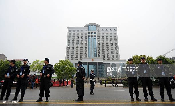 Police stand guard outside the Xianning Intermediate People's Court where Chinese mining tycoon Liu Han stands trial in Xianning central China's...