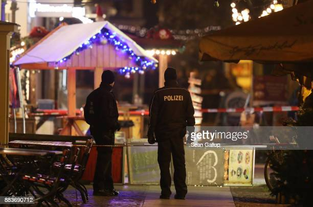 Police stand in a ropedoff area at a Christmas market close to where an explosive device was found earlier in the day on December 1 2017 in Potsdam...