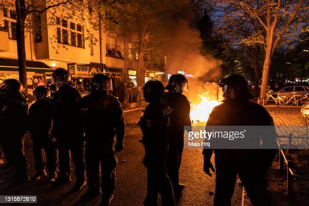 """Police stand in front of a fire during the annual """"Revolutionary May 1"""" leftist protest march on May Day during the third wave of the coronavirus..."""