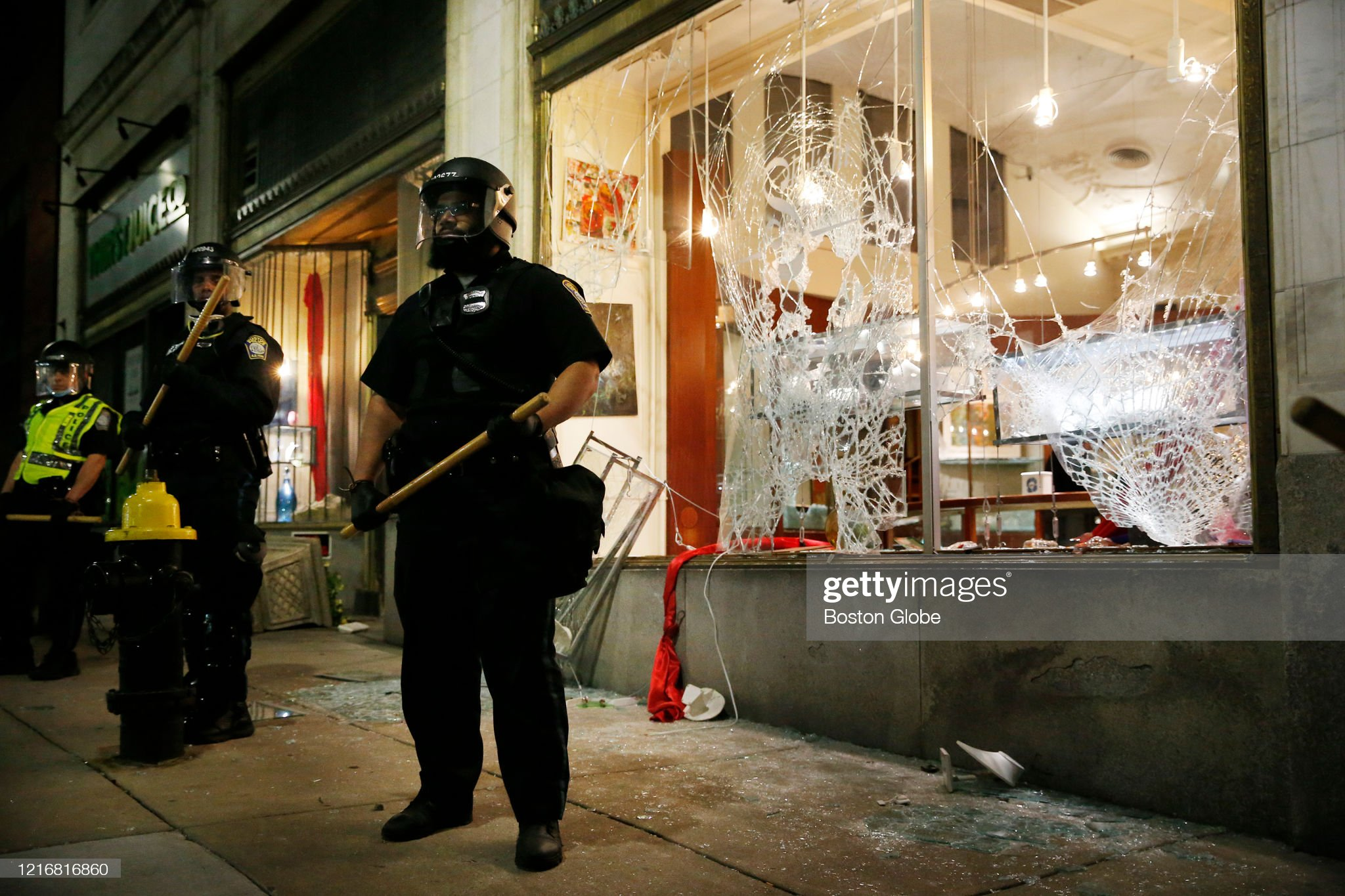 police-stand-in-front-of-a-store-outside