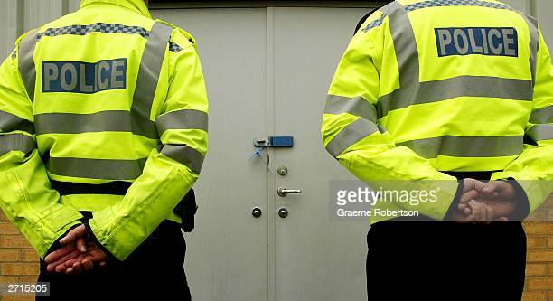Police stand in front of the door of the shelter where the cloths of the two girls were found in a bin November 10 2003 in Soham England Outofcourt...