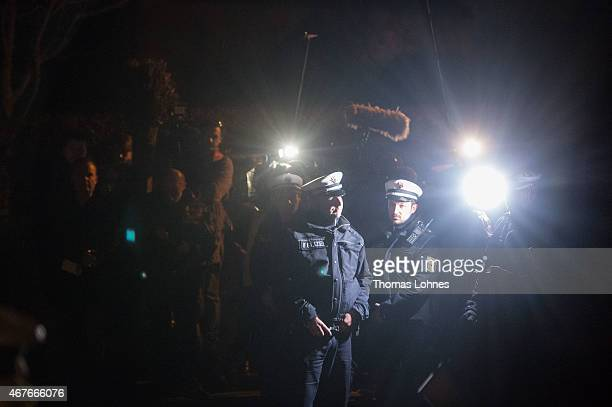 Police stand in front of the residence of the parents of Andreas Lubitz copilot on Germanwings flight 4U9525 on March 26 2015 in Montabaur Germany...