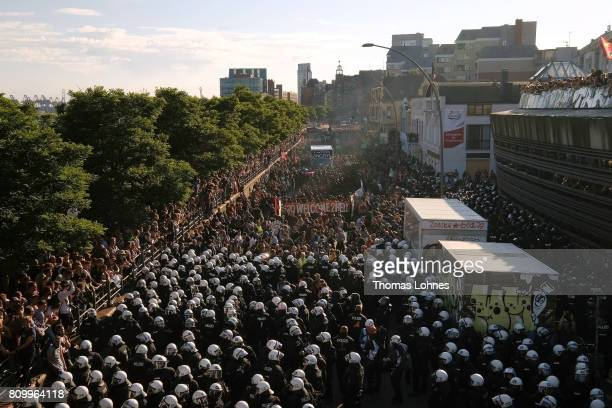 Police stand in front of the âWelcome to Hell❠antiG20 protest march at Hamburg harbor on July 6 2017 in Hamburg Germany Leaders of the G20 group of...