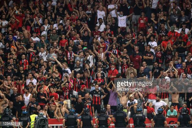 Police stand in line in front of OGC Nice fans during the French L1 football match between OGC Nice and Olympique de Marseille at the Allianz Riviera...