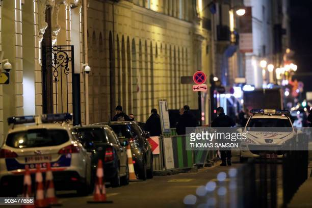 Police stand in rue Cambon at the back entrance of the Ritz luxury hotel in Paris on January 10 after an armed robbery Armed robbers made off with...